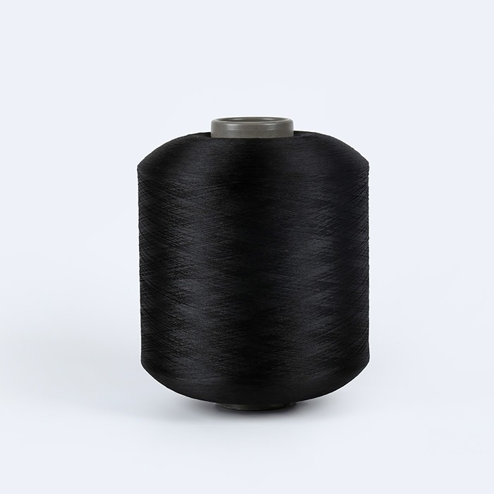 Dope dyed black polyester filament yarn